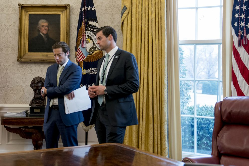 Treasury Secretary Steve Mnuchin's Chief of Staff Eli Miller, left, and then-White House Staff Secretary Rob Porter, right, stand in the Oval Office as President Donald Trump speaks at a tax reform meeting with American workers at the White House, Wednesday, Jan. 31, 2018, in Washington. (Andrew Harnik/AP)