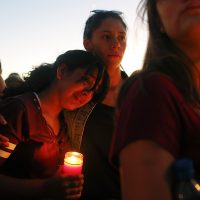 Students gather during a vigil at Pine Trails Park for the victims of the Wednesday shooting at Marjory Stoneman Douglas High School, in Parkland, Fla., Thursday, Feb. 15, 2018. (Brynn Anderson/AP)