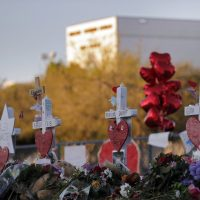 A makeshift memorial is seen outside the Marjory Stoneman Douglas High School, where 17 students and faculty were killed in a mass shooting on Wednesday, in Parkland, Fla., Monday, Feb. 19, 2018. Nikolas Cruz, a former student, was charged with 17 counts of premeditated murder on Thursday. (Gerald Herbert/AP)