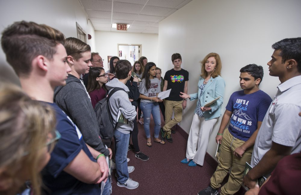 Florida Rep. Kristin Jacobs talks with student survivors from Marjory Stoneman Douglas High School in the hallway at the Florida Capitol in Tallahassee, Fla., Feb 21, 2018. (Mark Wallheiser/AP)