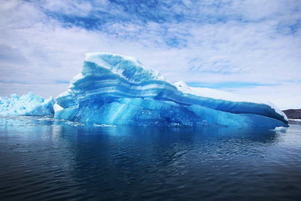 Calved icebergs from the nearby Twin Glaciers are seen floating on the water on July 30, 2013 in Qaqortoq, Greenland. (Joe Raedle/Getty Images)