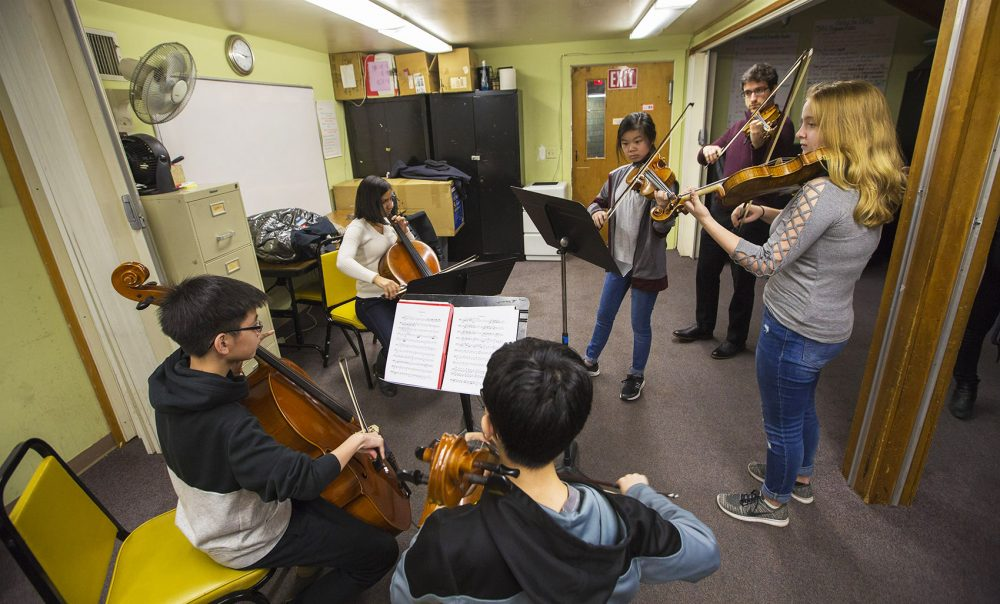 Boston String Academy students and teachers rehearse together at the Boston Chinese Evangelical Church in Chinatown. (Jesse Costa/WBUR)