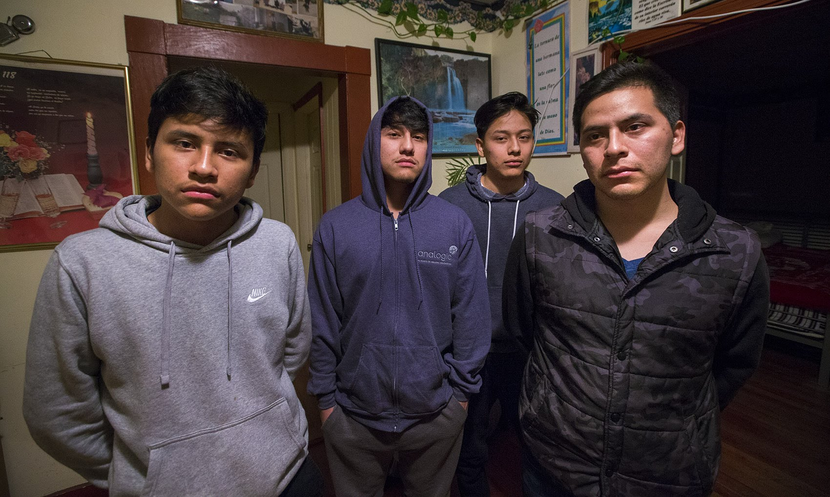 From left, the Macario brothers: Saul, 16, Erwin, 21, Anthony, 18, and Isidro, 27. Unlike his brothers, Isidro was not born in the U.S. and was deported to Guatemala on Wednesday. (Jesse Costa/WBUR)