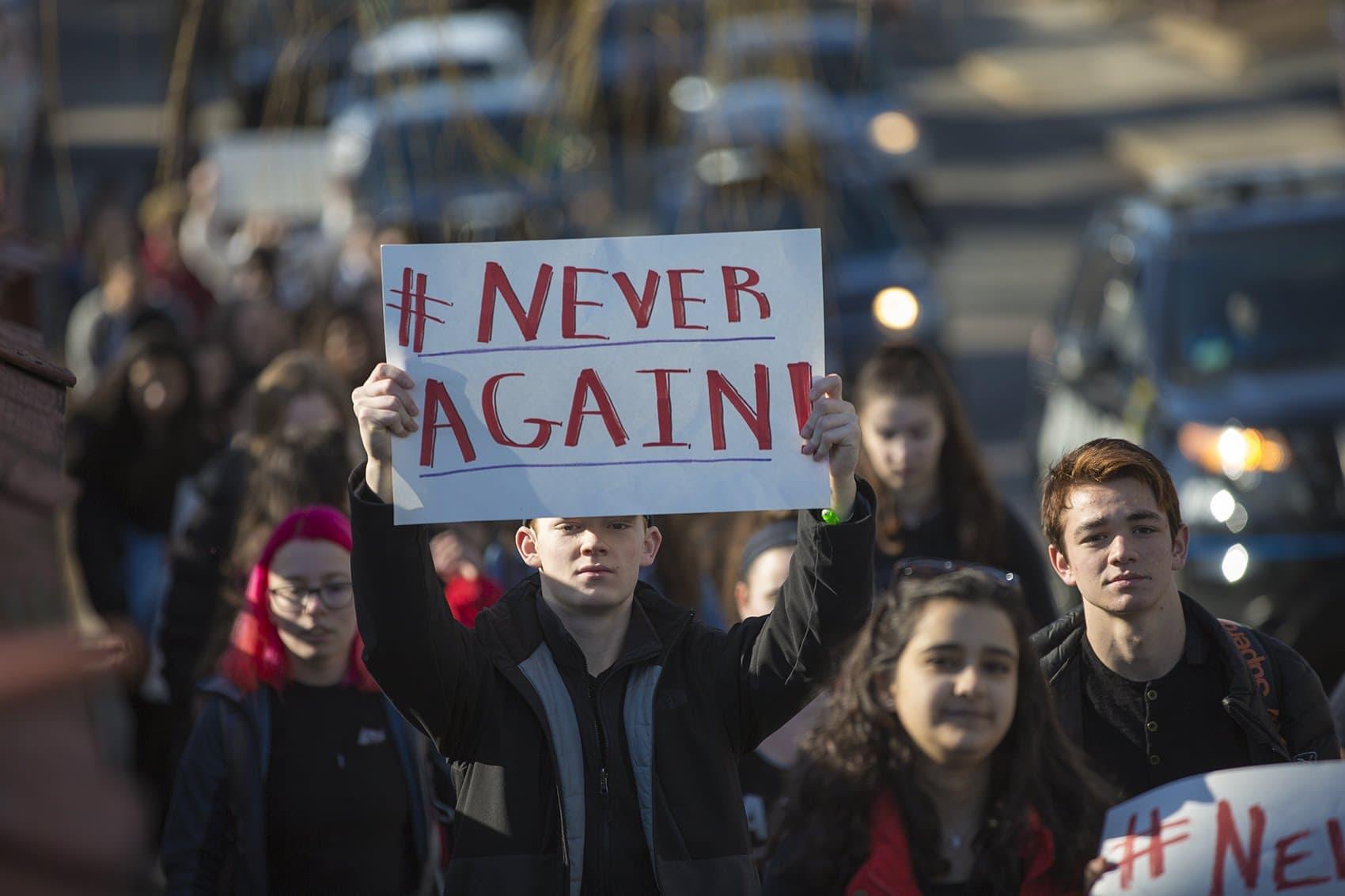 Somerville High School students march down Cedar Street toward Trum Field. (Jesse Costa/WBUR)