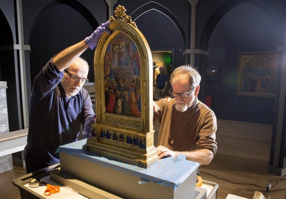 "The Gardner Museum's chief conservator Gianfranco Pocobene and senior preparator David Kalan prepare the display space for Fra Angelico's ""Coronation of the Virgin."" (Robin Lubbock/WBUR)"