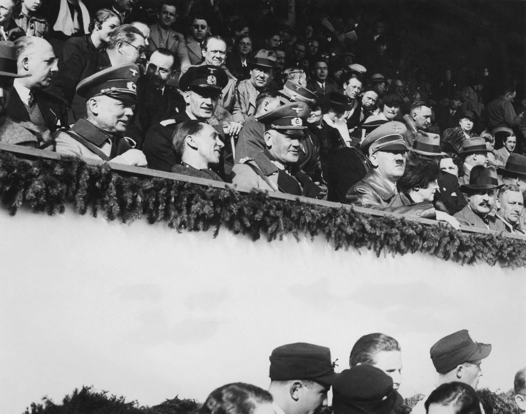 German Chancellor Adolf Hitler watches the final ski jumping contest in the Winter Olympics at Garmisch-Partenkirchen, Germany, in February 1936. (Keystone/Hulton Archive/Getty Images)