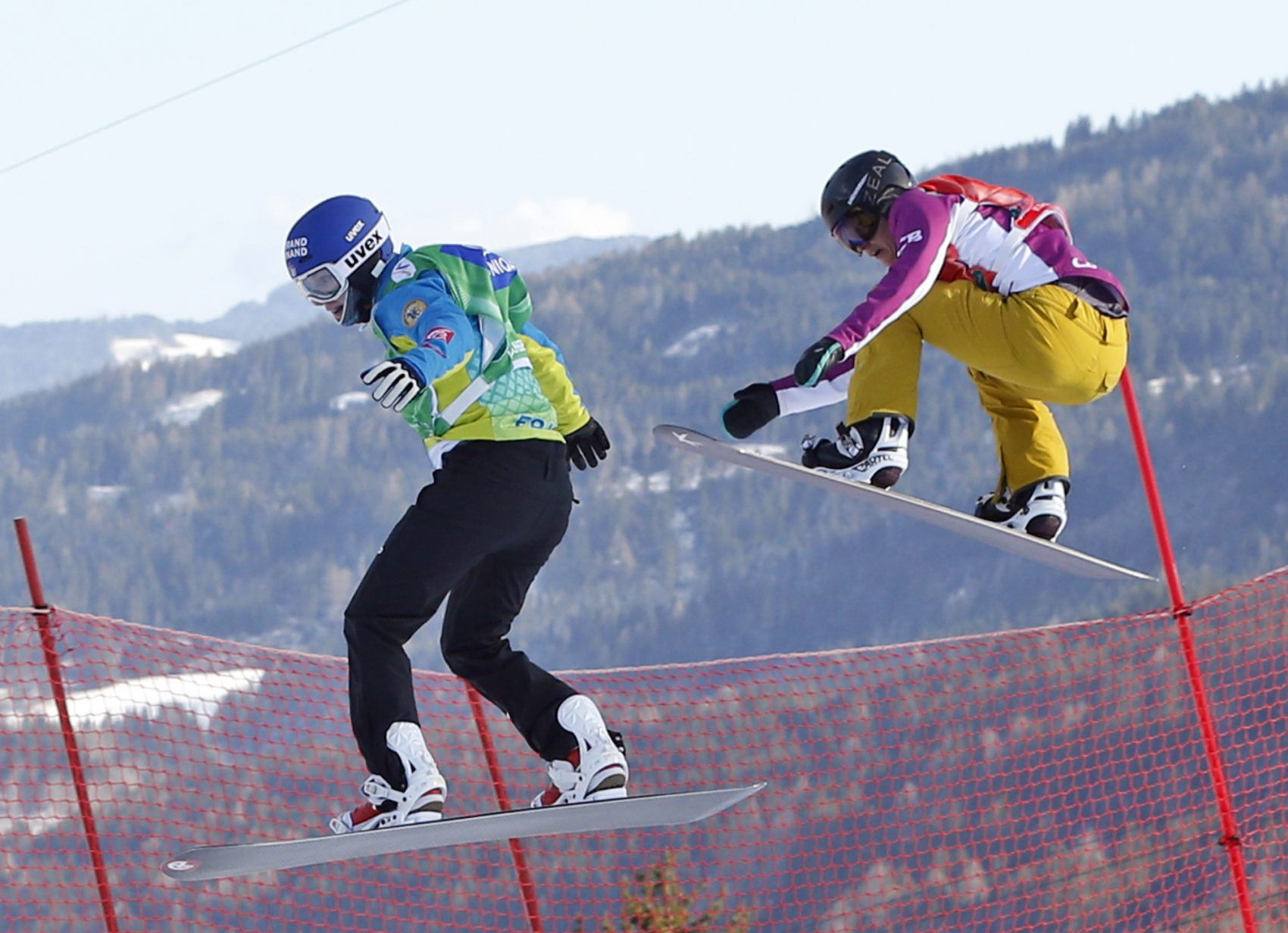 Lindsey Jacobellis, right, from the U.S. competes to win the snowboard cross event at the Freestyle Ski and Snowboard World Championships in Kreischberg, Austria, Friday, Jan. 16, 2015. (Darko Bandic/AP)