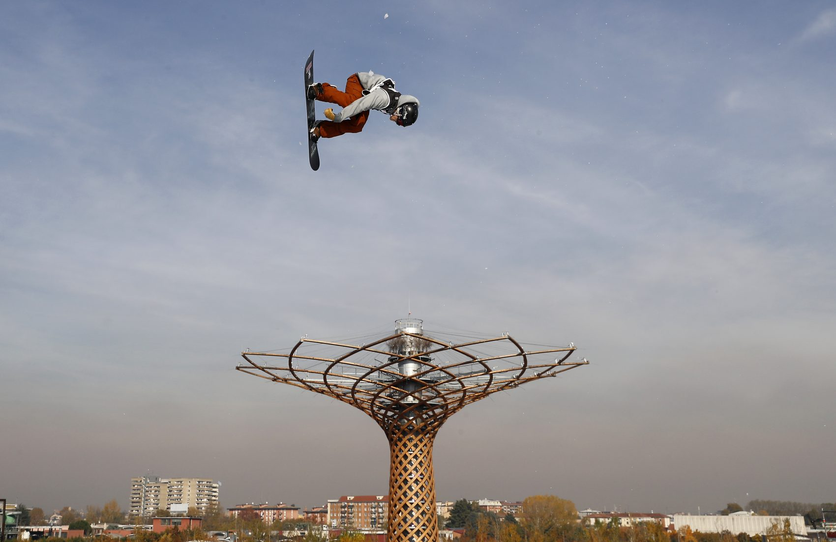 Ryan Stassel, of the United States soars through the air during the snowboard men's World Cup big air event, in Rho, near Milan, Italy, Saturday, Nov. 11, 2017. (Antonio Calanni/AP)
