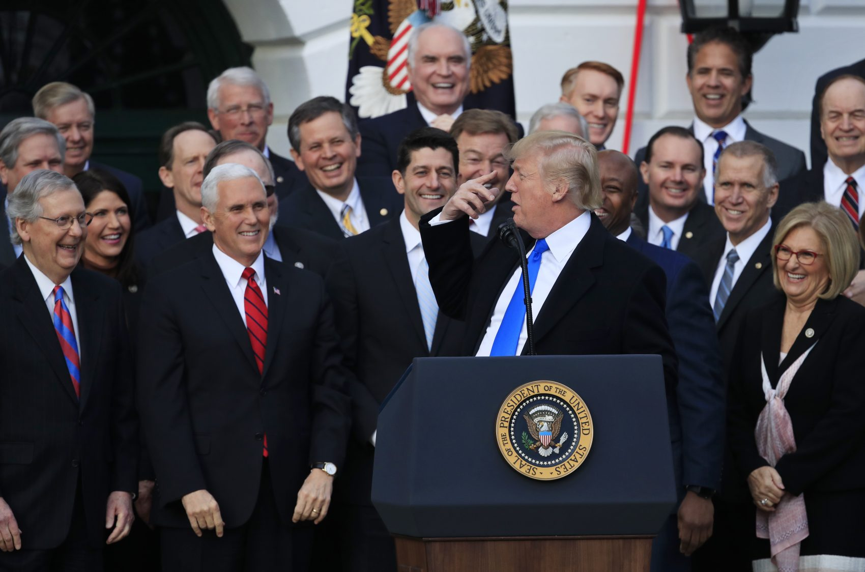 From left, Senate Majority Leader Mitch McConnell of Ky., Vice President Mike Pence, House Speaker Paul Ryan of Wis., and Republican lawmakers, react as President Donald Trump speaks (Manuel Balce Ceneta/AP)