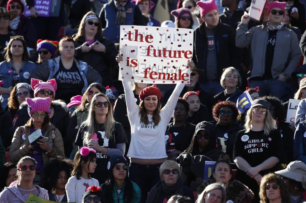 People cheer during a women's march rally Sunday, Jan. 21, 2018, in Las Vegas. (John Locher/AP)