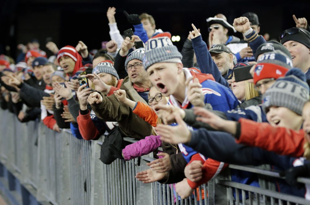 Patriots fans cheer as Patriots players leave the field after the AFC championship game against the Jaguars, on Jan. 21, 2018, in Foxborough, Mass. The Patriots won 24-20. (David J. Phillip/AP)