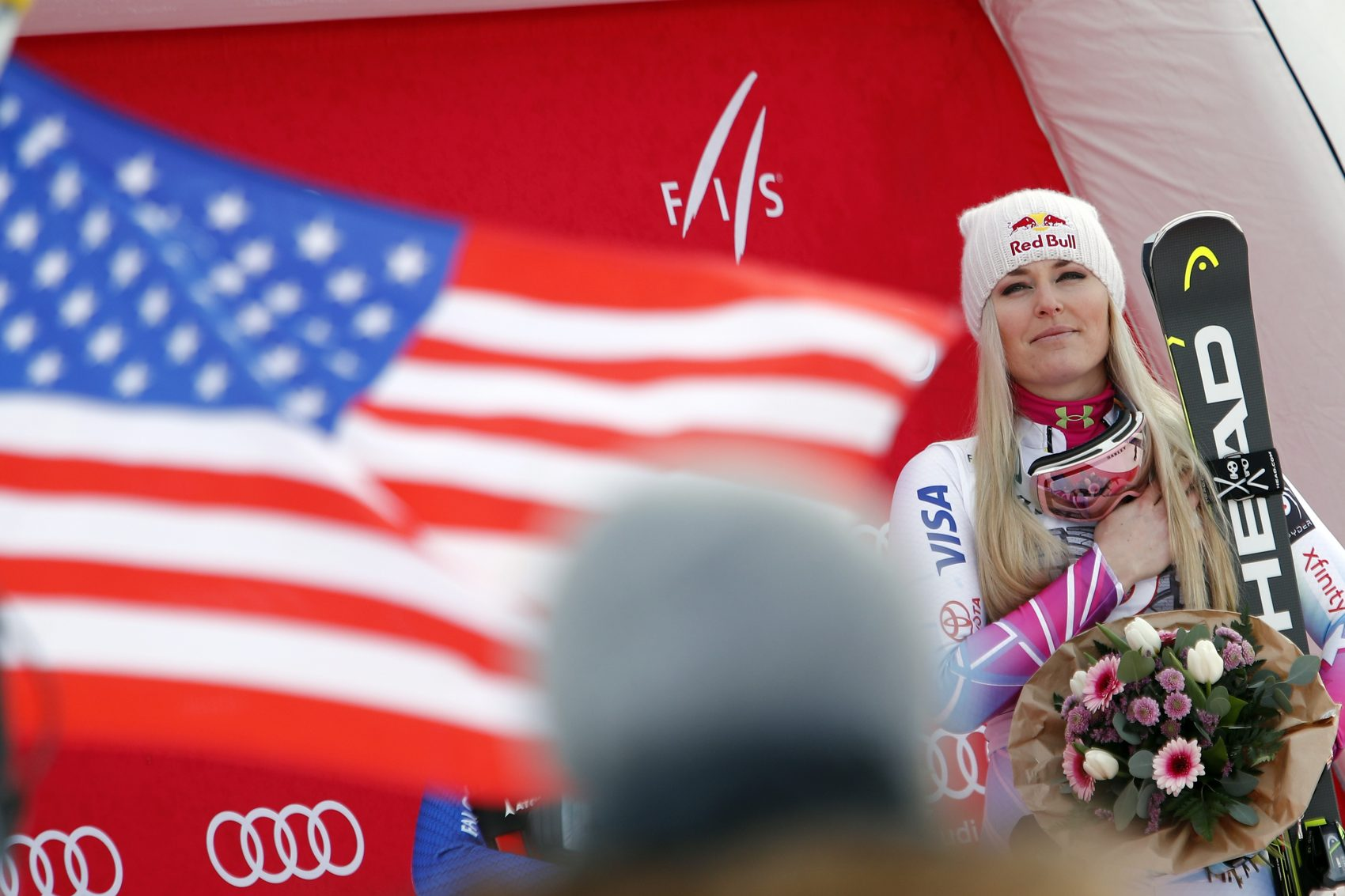 First placed United States' Lindsay Vonn listens to the national anthem at the end of an alpine ski, women's world Cup downhill race, in Garmisch Partenkirchen, Germany, Saturday Feb. 3, 2018. (Gabriele Facciotti/AP)