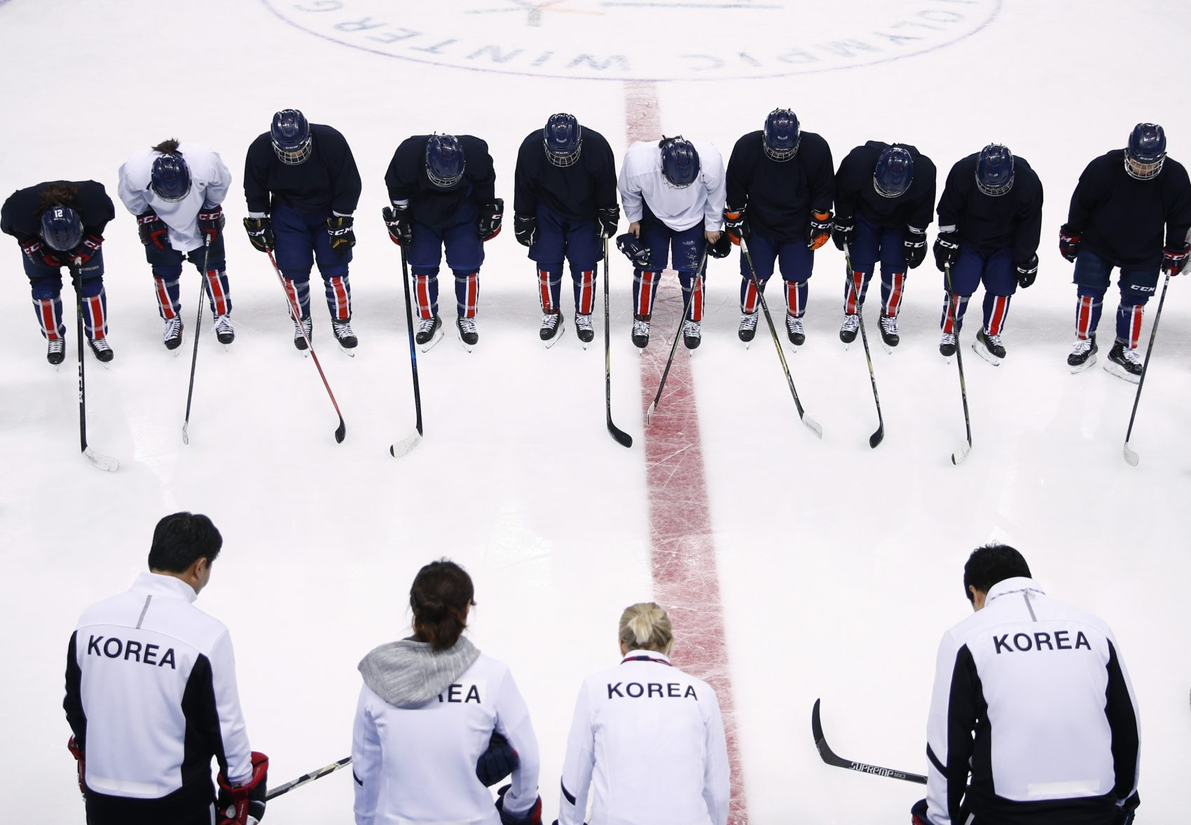 The combined Korean women's ice hockey players bow to their coaching staff after a practice session prior to the 2018 Winter Olympics in Gangneung, South Korea, Monday, Feb. 5, 2018. (Jae C. Hong/AP)