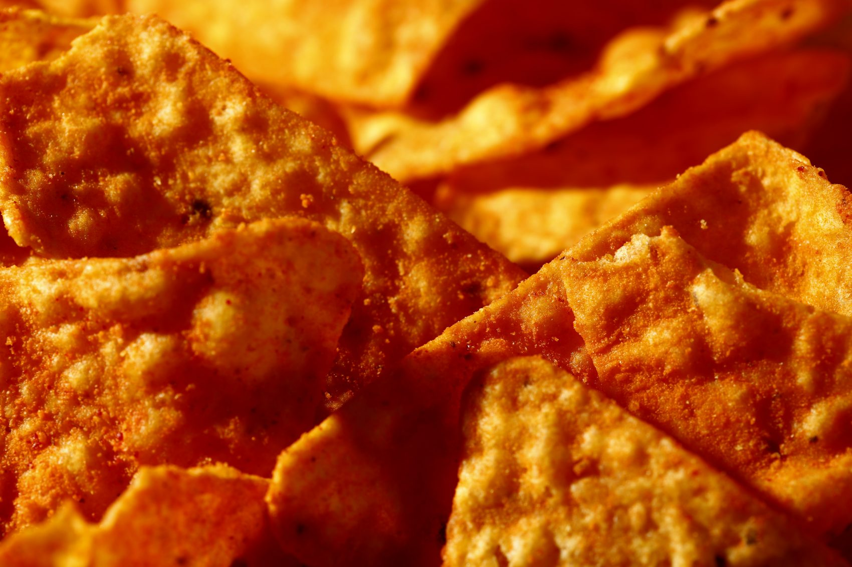 """This file photo shows Nacho Cheese flavored Doritos in Philadelphia. Don't expect to see """"lady Doritos"""" on store shelves. The company that makes the cheesy chips said Tuesday, Feb. 6, 2018, that it's not developing a line of Doritos designed specifically for women, despite widespread online speculation that it was. (Matt Rourke/AP)"""