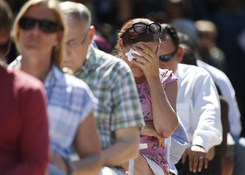 Attendees react at a prayer vigil for the victims of the shooting at Marjory Stoneman Douglas High School at the Parkland Baptist Church, Thursday, Feb. 15, 2018 in Parkland, Fla.  Nikolas Cruz, a former student, was charged with 17 counts of premeditated murder Thursday morning. (AP Photo/Wilfredo Lee)