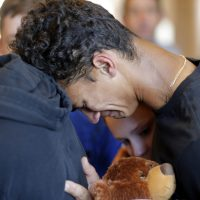 Austin Burden, 17, cries on the shoulder of a friend after a vigil at the Parkland Baptist Church, for the victims of the Wednesday shooting at Marjory Stoneman Douglas High School, in Parkland, Fla., Thursday, Feb. 15, 2018. Nikolas Cruz, a former student, was charged with 17 counts of premeditated murder on Thursday. (Gerald Herbert/AP)