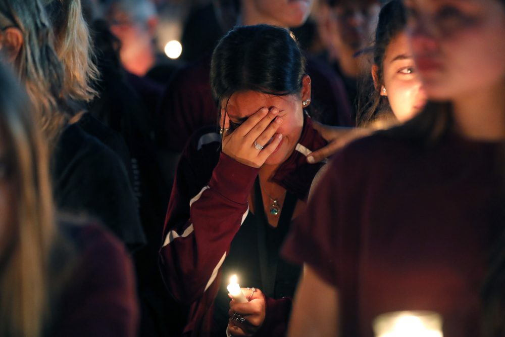 A woman cries during a candlelight vigil for the victims of the Wednesday shooting at Marjory Stoneman Douglas High School, in Parkland, Fla., Thursday, Feb. 15, 2018.  (Gerald Herbert/AP)