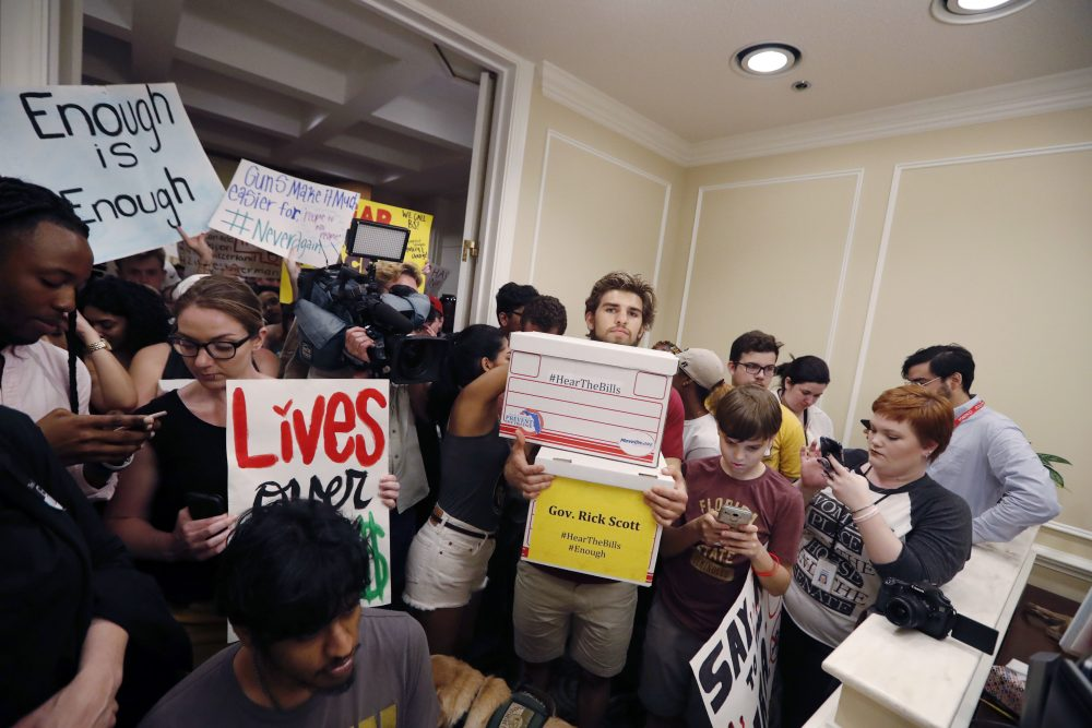 People crowd the entrance to the office of Florida Gov. Rick Scott with boxes of petitions for gun control reform, after a rally on the steps of the state Capitol in Tallahassee, Fla., Wednesday. Seventeen students and teachers were killed last Wednesday in a mass shooting at Marjory Stoneman Douglas High School in Parkland, Fla. (Gerald Herbert/AP)
