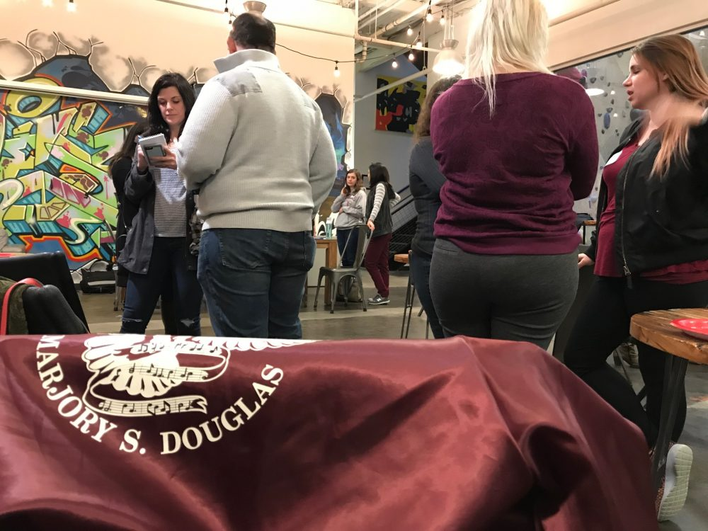 Alumni of the Marjory Stoneman Douglas High School in Parkland, Florida, are organizing groups across the country to support the #NeverAgain movement. A group met here in Somerville. (Carrie Jung/WBUR)