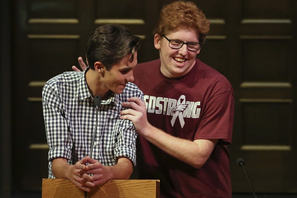 David Hogg, gets a pat on the back from Matthew Deitsch, as student survivors from Marjory Stoneman Douglas High School in Parkland, Fla. addresses a community rally for common sense gun legislation at Temple B'nai Abraham Sunday, Feb. 25, 2018, in Livingston, N.J. Speakers include survivors Hogg, Deitsch and his brother Matthew Deitsch. (Rich Schultz/AP)