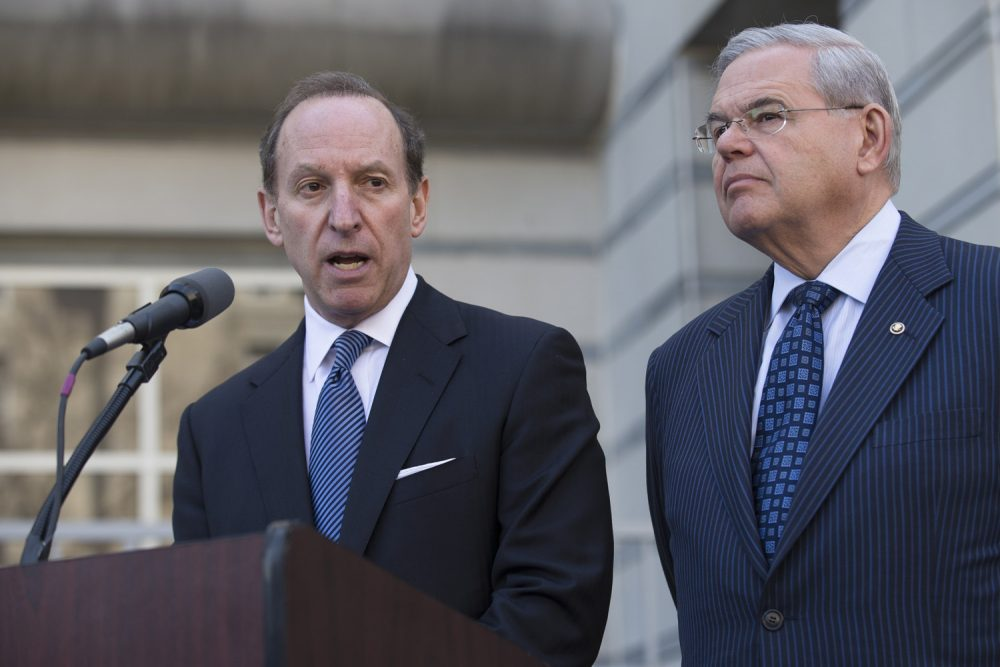 Attorney Abbe Lowell speaks alongside U.S. Sen. Bob Menendez after leaving the Martin Luther King Jr. Federal Courthouse following his client's arraignment, Thursday, April 2, 2015, in Newark, N.J.  (AP Photo/John Minchillo)