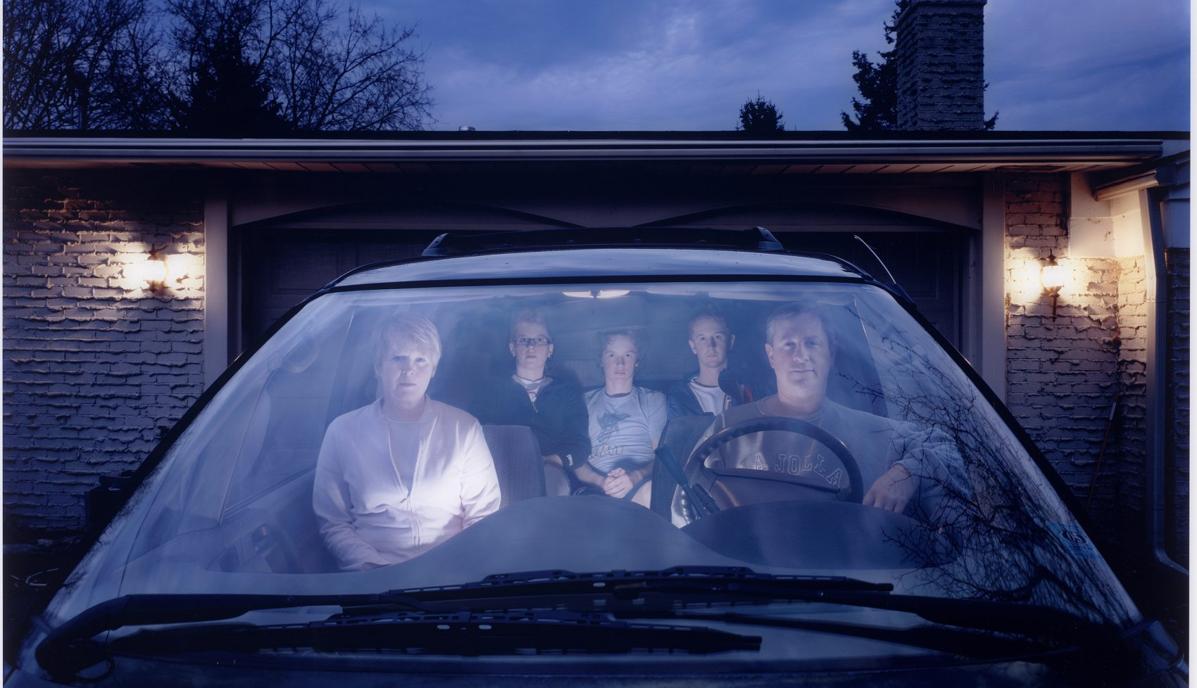 "Julie Mack's ""Self-portrait with family in SUV, Michigan,"" taken in 2007. (Courtesy Julie Mack/Laurence Miller Gallery, New York; Museum of Fine Arts, Boston)"