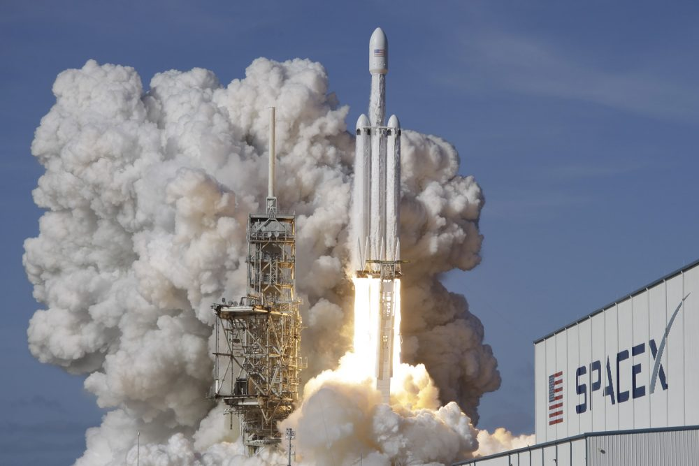 A Falcon 9 SpaceX heavy rocket lifts off from pad 39A at the Kennedy Space Center in Cape Canaveral, Fla., Tuesday, Feb. 6, 2018. The Falcon Heavy, has three first-stage boosters, strapped together with 27 engines in all. (AP Photo/John Raoux)