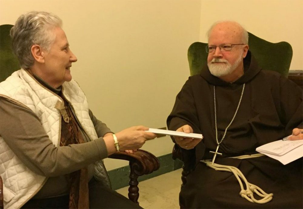 Marie Collins hands the letter written by Juan Carlos Cruz to Cardinal Sean O'Malley in April 2015. (Courtesy of Catherine Bonnet)