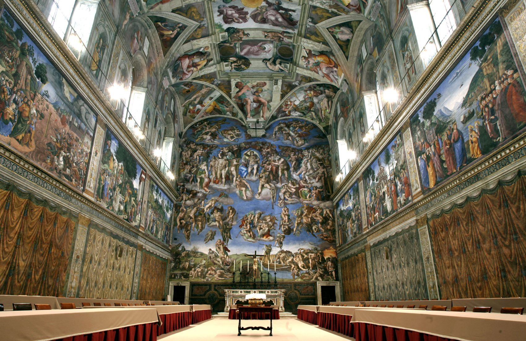 Five centuries after Michelangelo's ceiling frescoes were inaugurated at the Sistine Chapel, at least 10,000 people visit the site each day. (Pier Paolo Cito/AP)
