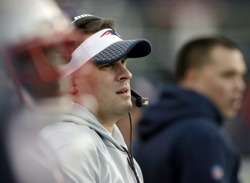 New England Patriots offensive coordinator Josh McDaniels watches from the sideline during the first half of the AFC championship NFL football game against the Jacksonville Jaguars, Sunday, Jan. 21, 2018, in Foxborough, Mass. (AP Photo/Charles Krupa)