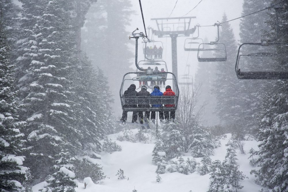 In this photo provided by Northstar California, skiers ride a chair lift as snow falls Thursday, March 1, 2018, at the Northstar California resort in Truckee, Calif. A major winter storm moved across Northern California on Thursday, bringing heavy snow and strong winds to the Sierra Nevada and steady rain through the region that disrupted the morning commute. (Northstar California via AP)