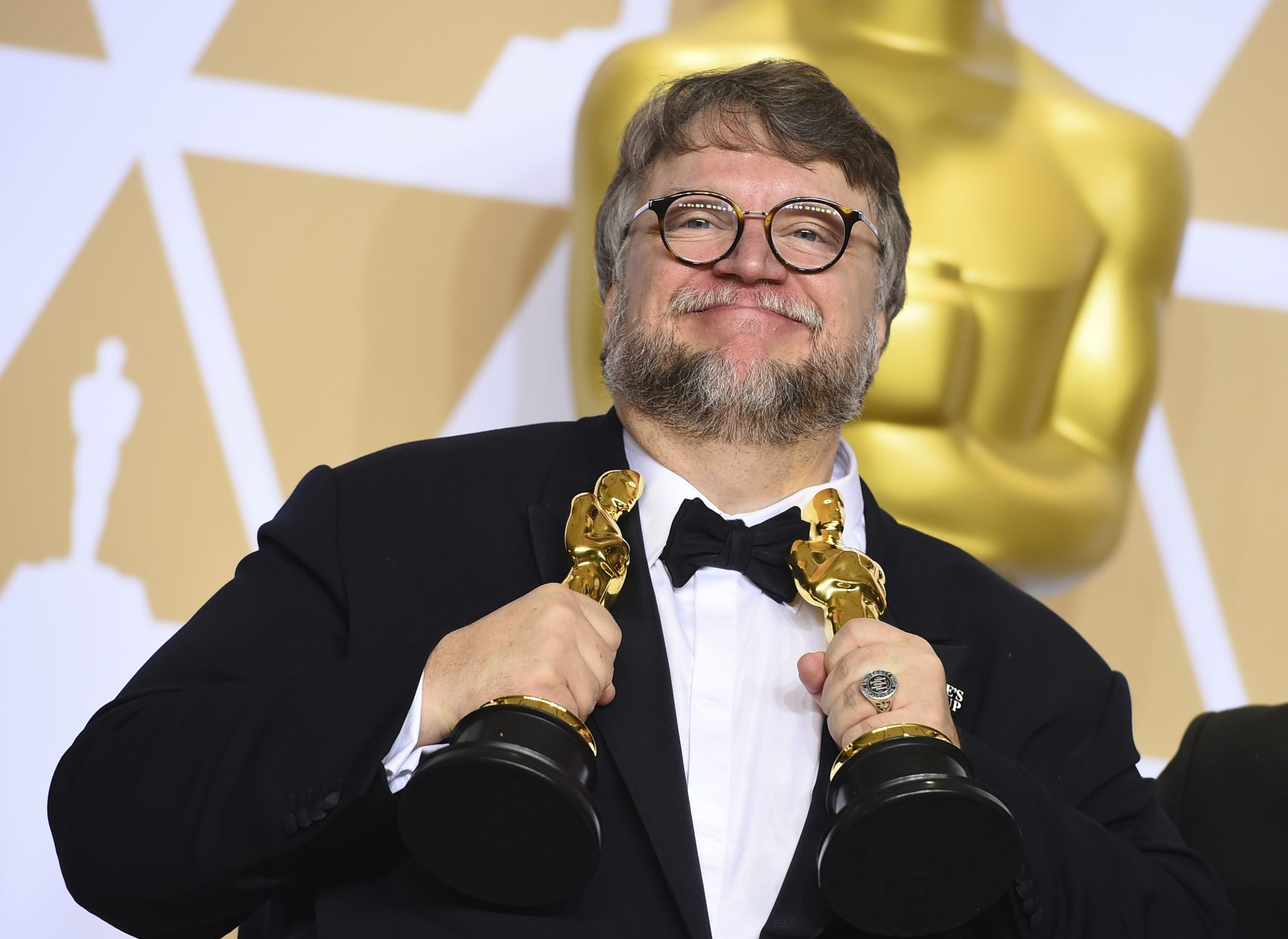 """Guillermo del Toro, winner of the awards for best director for """"The Shape of Water"""" and best picture for """"The Shape of Water"""", poses at the Oscars in LA. (Jordan Strauss/Invision/AP)"""
