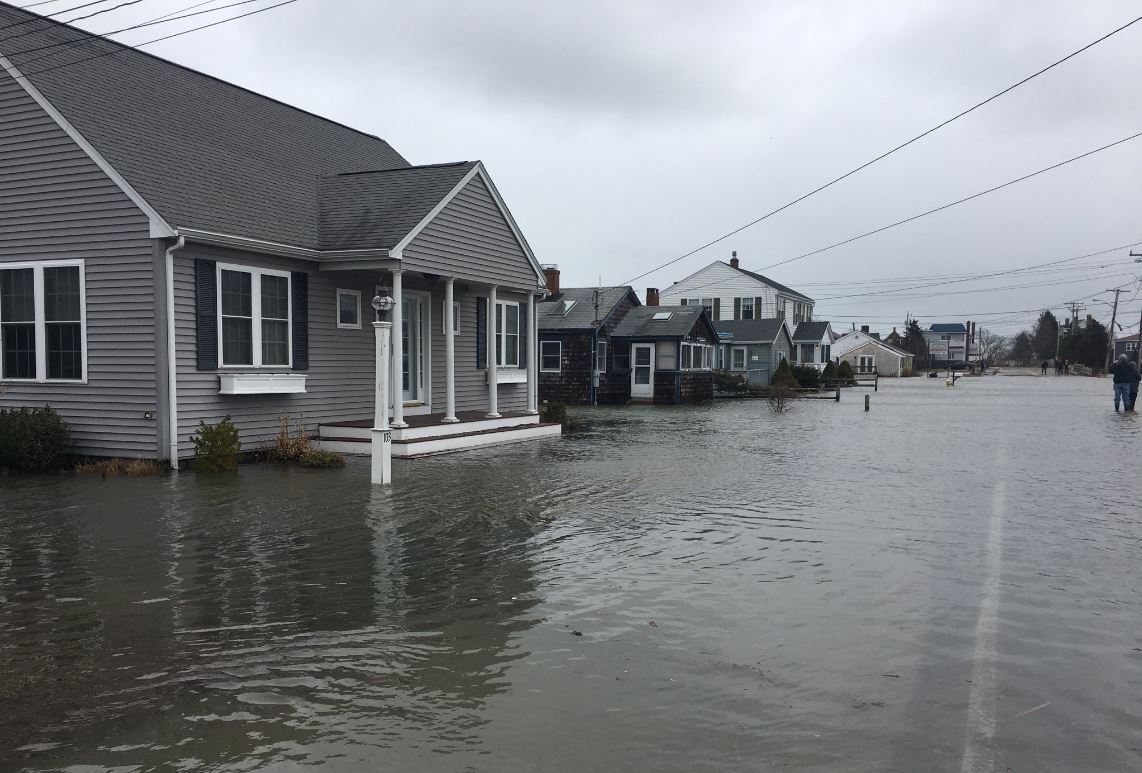 Governor Charlie Baker declared a state of emergency in the aftermath of storm Riley. Pictured here is Marion Street in Marshfield, Mass. Marshfield was just one of the coastal communities hit hard by the storm. (Bruce Gellerman/WBUR)