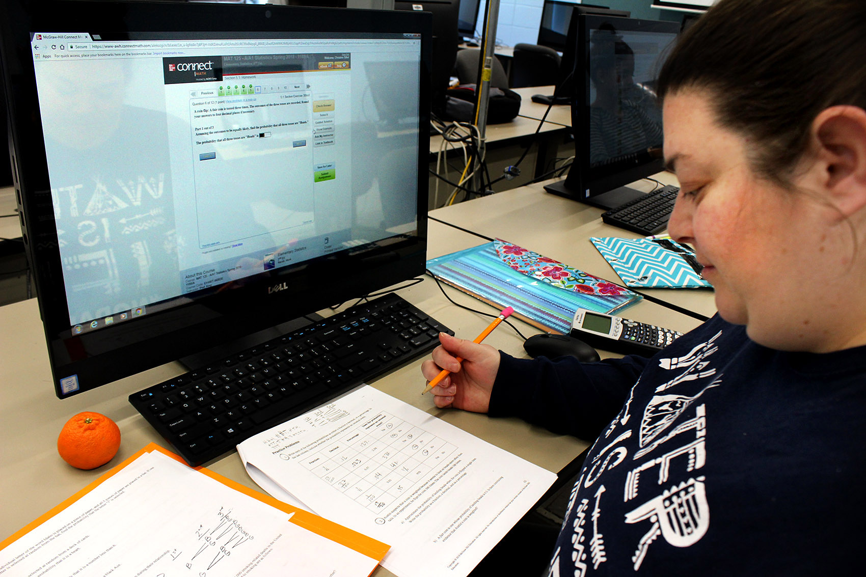 Christine Sifre works through probability equations in a statistics fusion course at Northern Essex Community College. (Carrie Jung/WBUR)