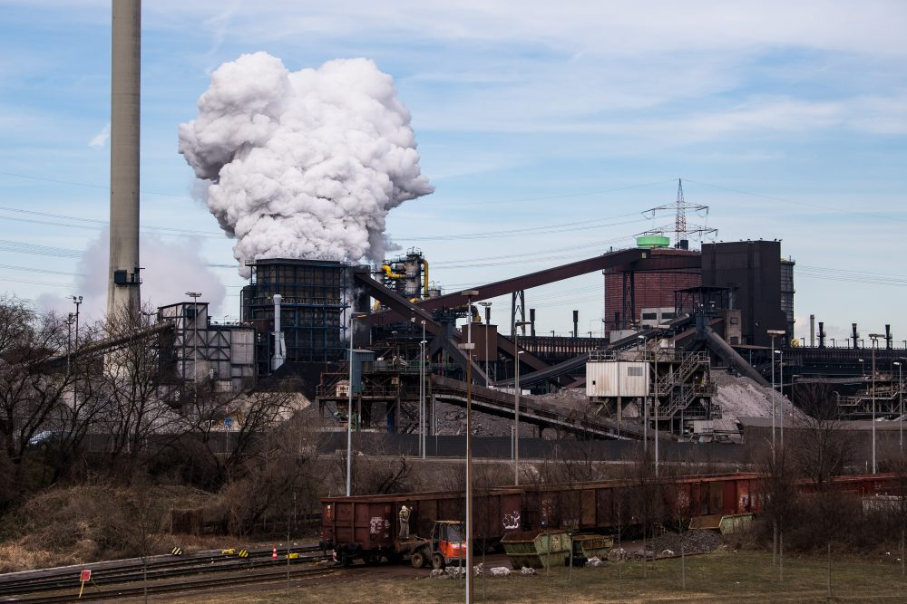 Steam rises from the Huettenwerk Krupp Mannesmann GmbH steel mill on March 5, 2018 in Duisburg, Germany. Tensions between President Trump and the European Union are rising after Trump announced he would respond to any EU tariffs on American goods with U.S. tariffs on European cars. Trump originally sought tariffs on imports of steel and aluminum, to which EU officials said they would respond with tariffs on U.S. jeans, motorcycles and bourbon. The European Union and Canada are the two biggest exporters of steel to the United States. (Lukas Schulze/Getty Images)