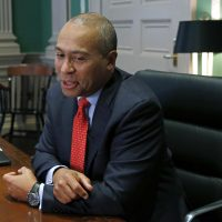 Former Massachusetts Gov. Deval Patrick speaks during an interview at his State House office in Boston in 2014. (Elise Amendola/AP)