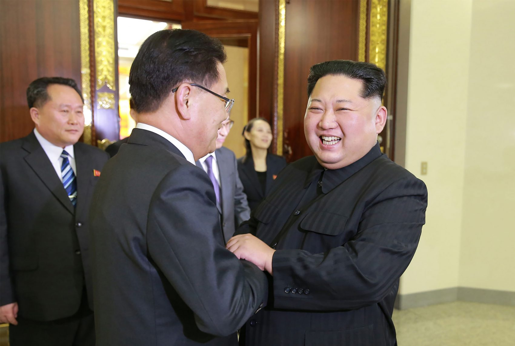 This picture taken on March 5, 2018 and released from North Korea's official Korean Central News Agency (KCNA) on March 6, 2018 shows North Korean leader Kim Jong Un (right) shaking hands with South Korean chief delegator Chung Eui-yong (center), who traveled as envoys of the South's President Moon Jae-in, during their meeting in Pyongyang. (STR/AFP/Getty Images)