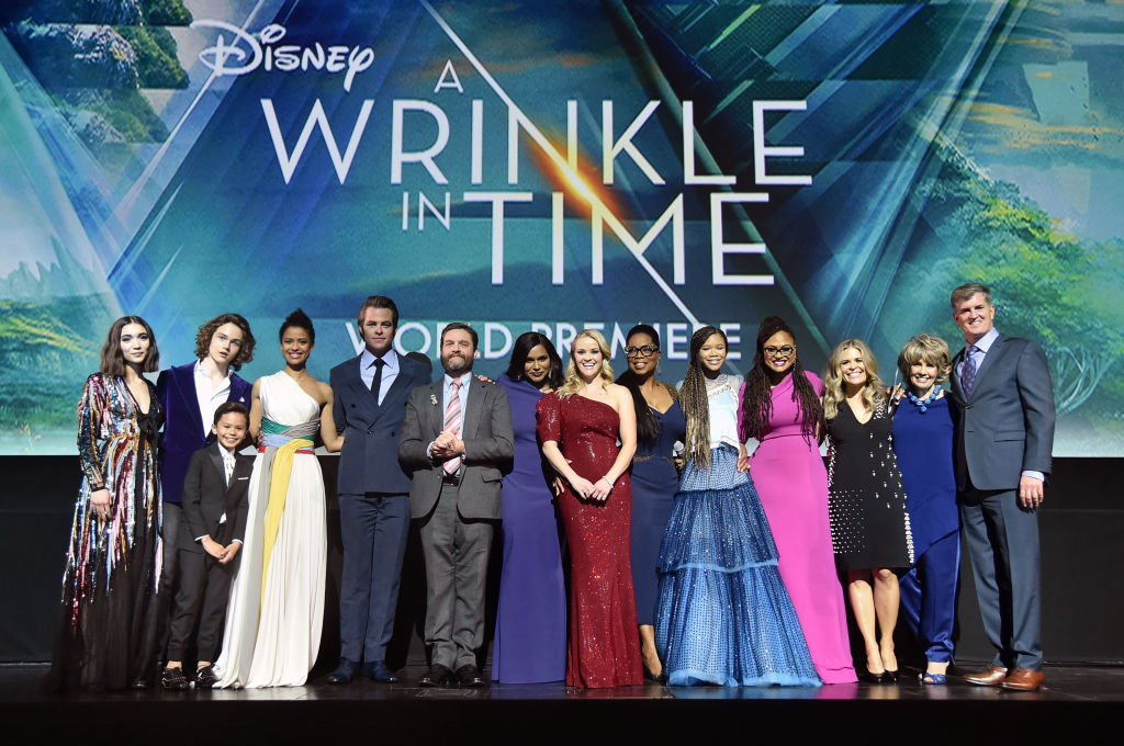 """(Left to right) Actors Rowan Blanchard, Levi Miller, Deric McCabe, Gugu Mbatha-Raw, Chris Pine, Zach Galifianakis, Mindy Kaling, Reese Witherspoon, Oprah Winfrey, Storm Reid, along with director Ava DuVernay, screenwriter Jennifer Lee, producers Catherine Hand and Jim Whitaker onstage at the world premiere of Disney's """"A Wrinkle in Time"""" at the El Capitan Theatre in Hollywood Calif., Feb. 26, 2018.  (Alberto E. Rodriguez/Getty Images for Disney)"""