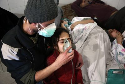 Syrians receive treatment for breathing difficulties at a clinic in Syria's eastern Ghouta on March 7, 2018, after regime airstrikes. (Amer Almohibany/AFP/Getty Images)