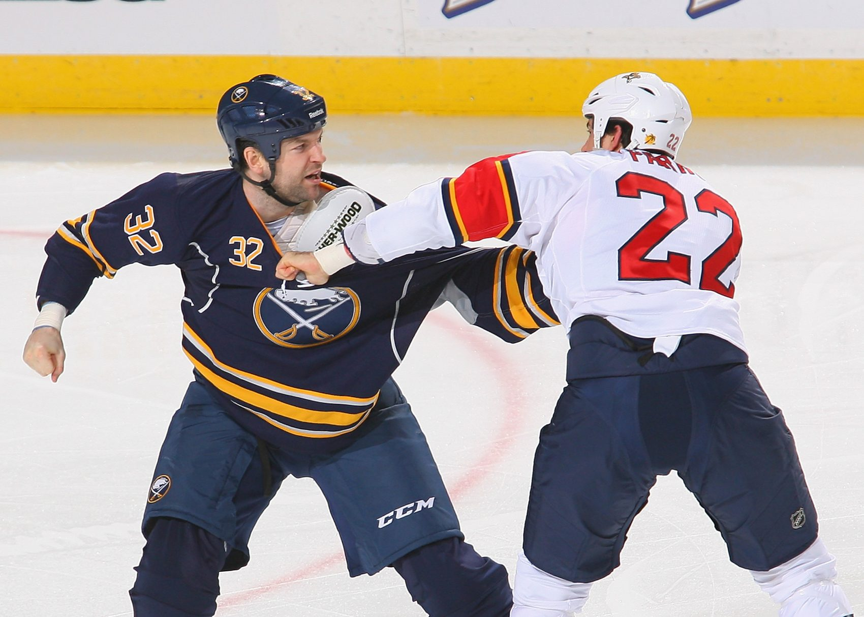 John Scott, left, made a name in the NHL brawling. But that's not his whole story. (Rick Stewart/Getty Images)