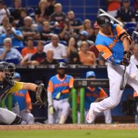 Giancarlo Stanton led the majors with 59 home runs in 2017. Analysis on the baseballs used in today's game has revealed they travel about 11 feet further than balls from four or five years ago. (Eric Espada/Getty Images)