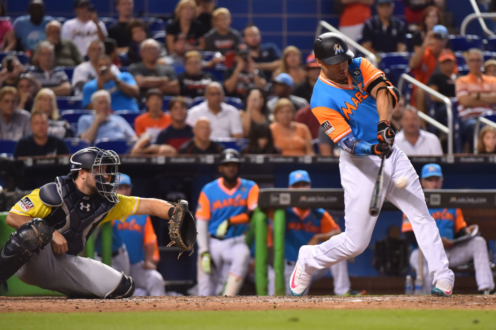 Giancarlo Stanton led the majors with 59 home runs in 2017. Analysis on the baseballs used in today's game has revealed they travel about 11 feet farther than balls from four or five years ago. (Eric Espada/Getty Images)