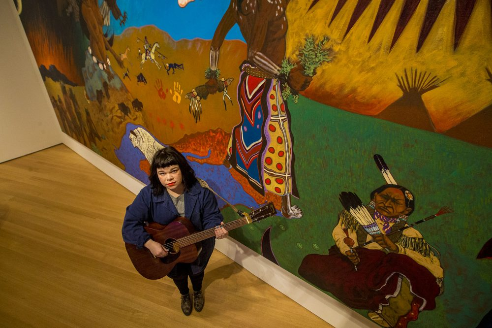 Here's musician Samantha Crain standing in front of Cannon's massive mural at the PEM. (Jesse Costa/WBUR)