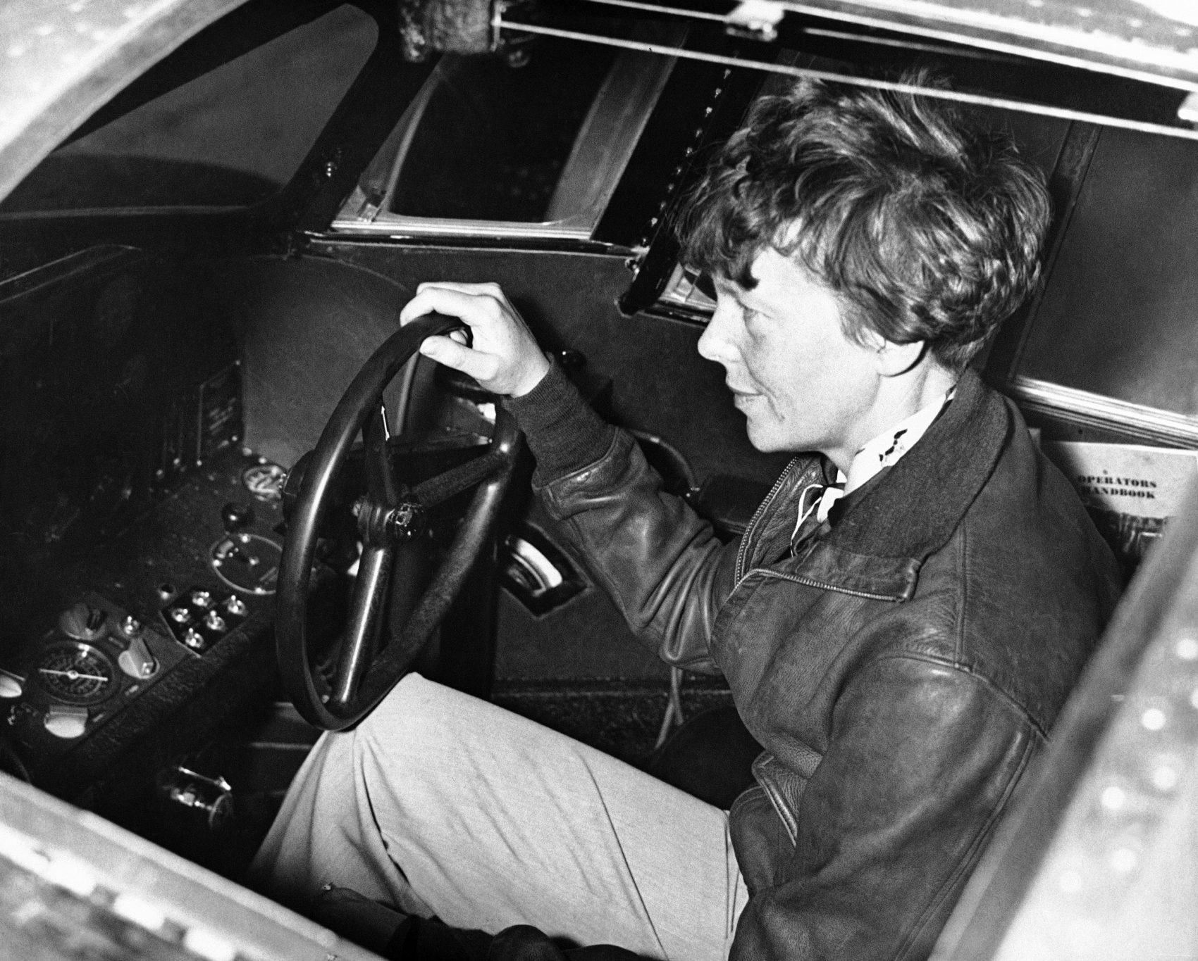 """In this image Amelia Earhart at the controls of her plane nicknamed the """"Flying Laboratory"""" on July 3, 1931. (AP Photo)"""