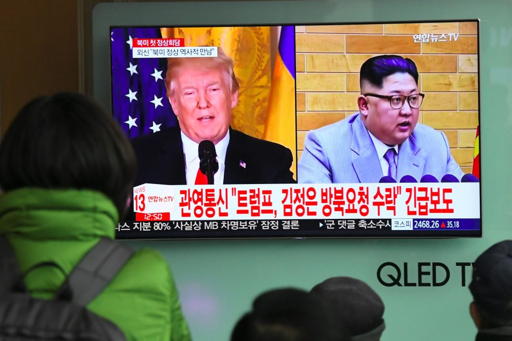 People watch a television news report showing pictures of President Trump and North Korean leader Kim Jong Un at a railway station in Seoul on March 9, 2018. (Jung Yeon-je/AFP/Getty Images)