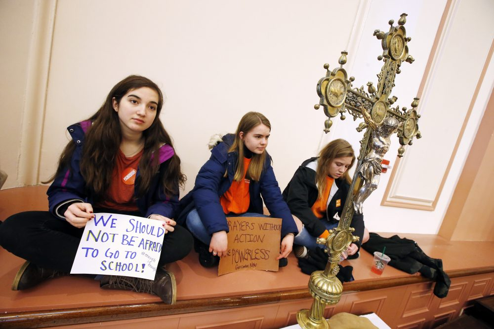 Boston-area highschoolers, from left, Cat Harris, 16, Molly O'Toole, 16, and Sarah von Schack, 15, listen to speeches inside St. Paul's Cathedral. (Michael Dwyer/AP)