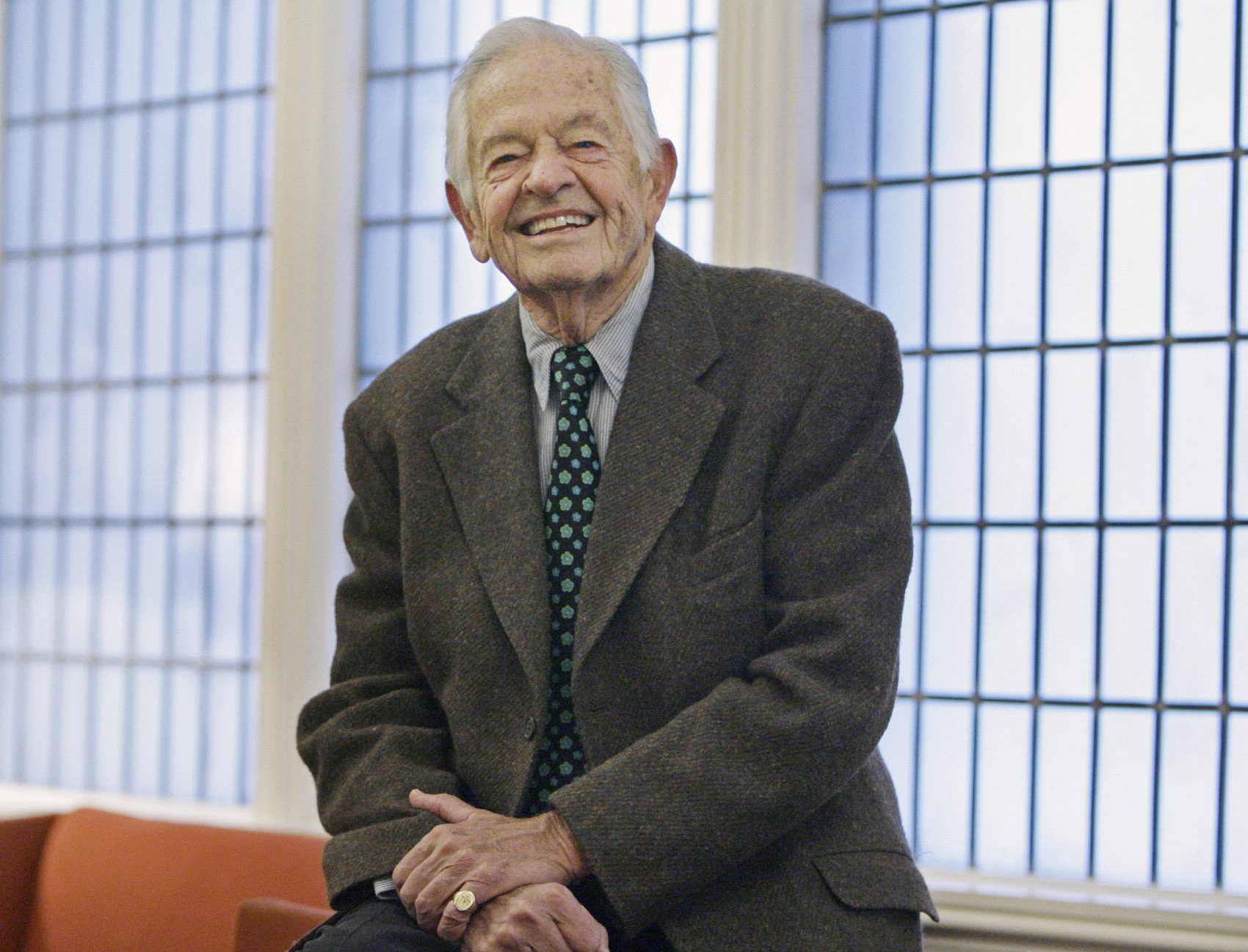 Renowned pediatrician Dr. T. Berry Brazelton smiles following an interview at the University Club in Chicago on Nov. 6, 2006. (M. Spencer Green/AP)