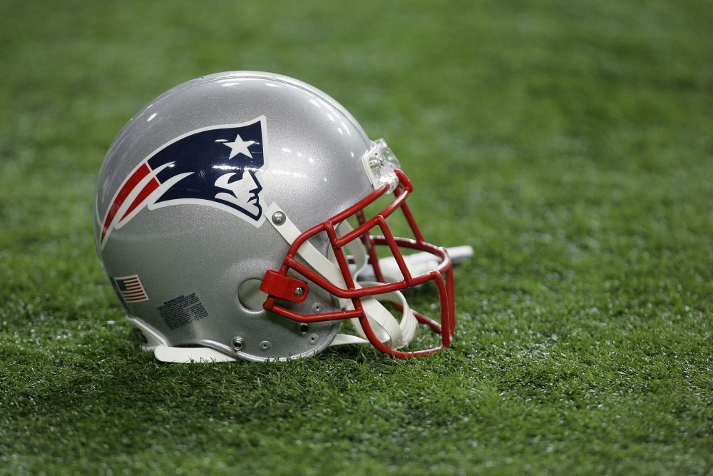 "According to the Boston Globe, more than 340 ""former Patriots or their estates"" have sued the NFL and the helmet maker Riddell. (Streeter Lecka/Getty Images)"