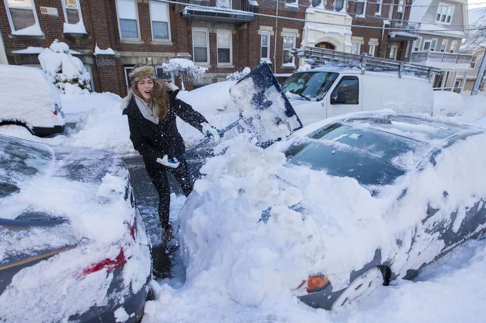 Karissa Medieros shovels her car out of the snow on Quint Street in Allston. (Jesse Costa/WBUR)