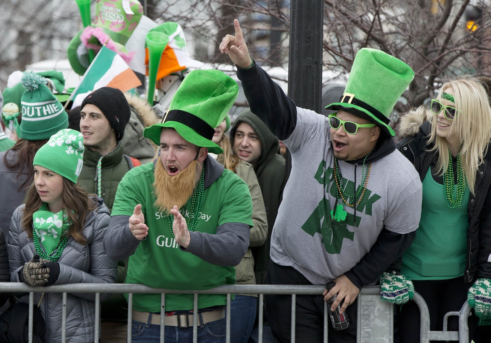 Spectators cheer during the annual St. Patrick's Day parade in Boston in 2017. (Michael Dwyer/AP)
